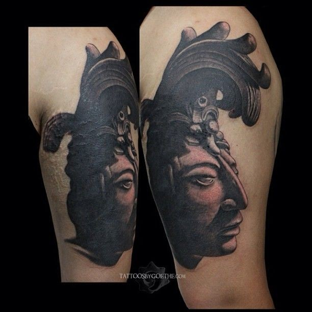 Black and gray shoulder tattoo of antic stone statue
