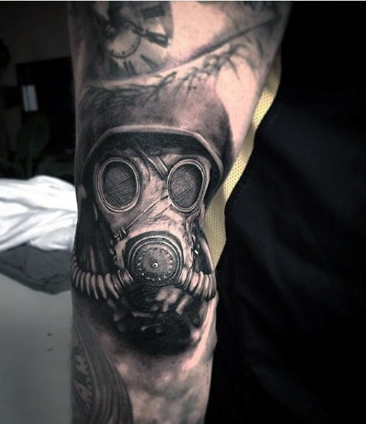 Black and gray style amazing looking detailed soldier in gas mask tattoo on arm