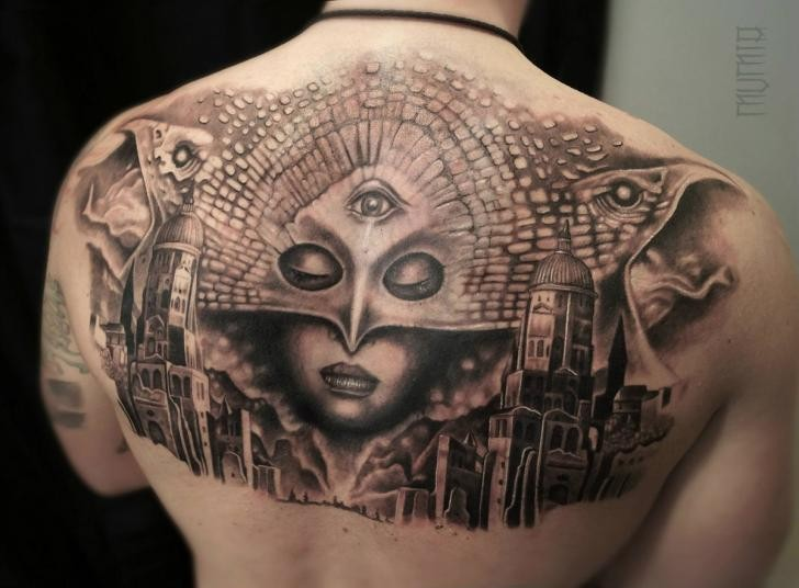 Black and gray style awesome upper back tattoo of mysterious woman with mask and city