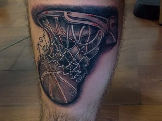 Black and gray style basketball with lettering tattoo on leg