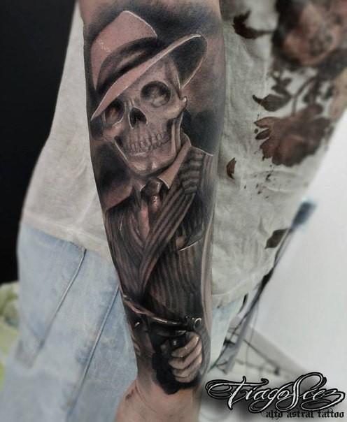 Black and gray style big arm tattoo of mafioso skeleton