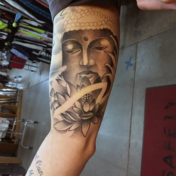 Black and gray style big biceps tattoo of Buddha statue with lotus flower