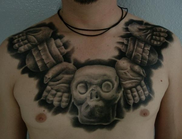 Black and gray style chest tattoo of ancient stone statue