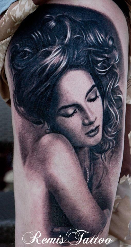 Black and gray style colored arm tattoo of seductive woman