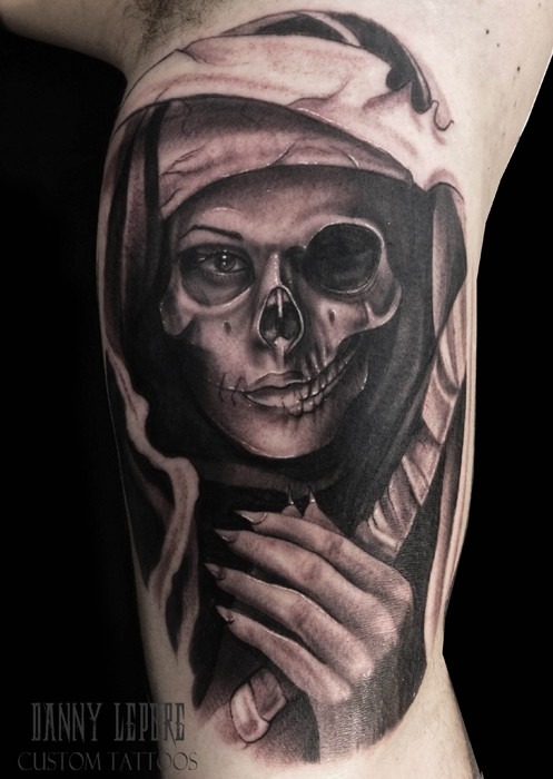Black and gray style colored biceps tattoo of Grimm reaper woman