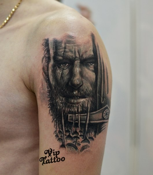 Black and gray style colored shoulder tattoo of old warrior with sword