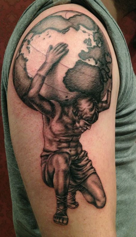 Black and gray style colored shoulder tattoo of man holding planet