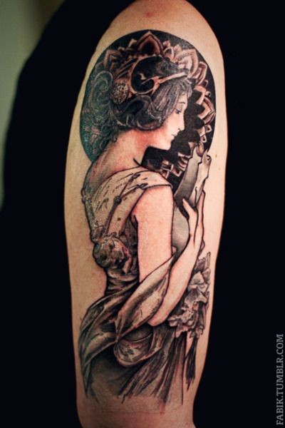 Black and gray style colored shoulder tattoo of woman portrait