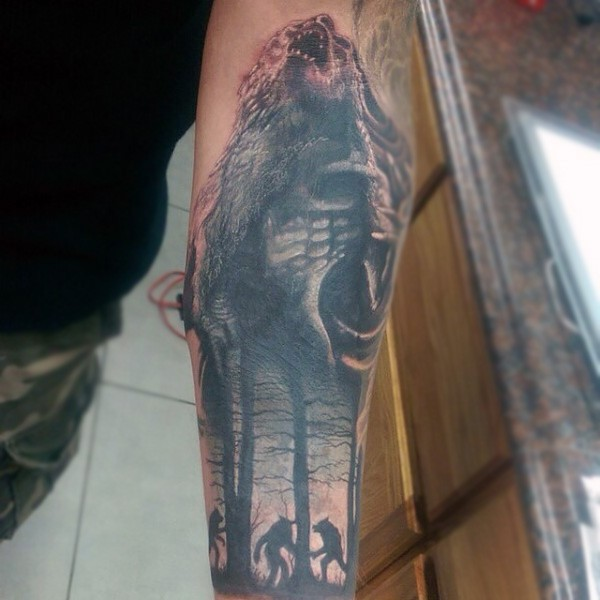 Black and gray style colored sleeve tattoo of werewolves in dark forest