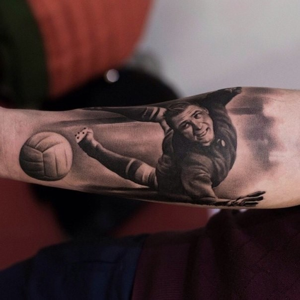 Black and gray style cool looking forearm tattoo of vintage football player