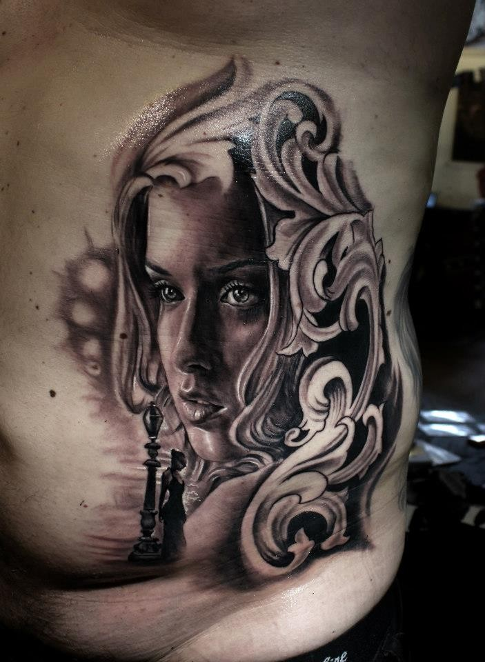 Black and gray style cool looking side tattoo of woman face with chess and ornaments
