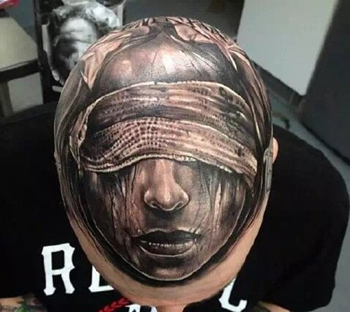 Black and gray style creepy looking blind woman face tattoo on head
