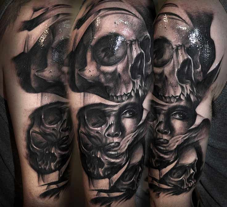 Black and gray style demonic woman portrait with skulls tattoo on shoulder