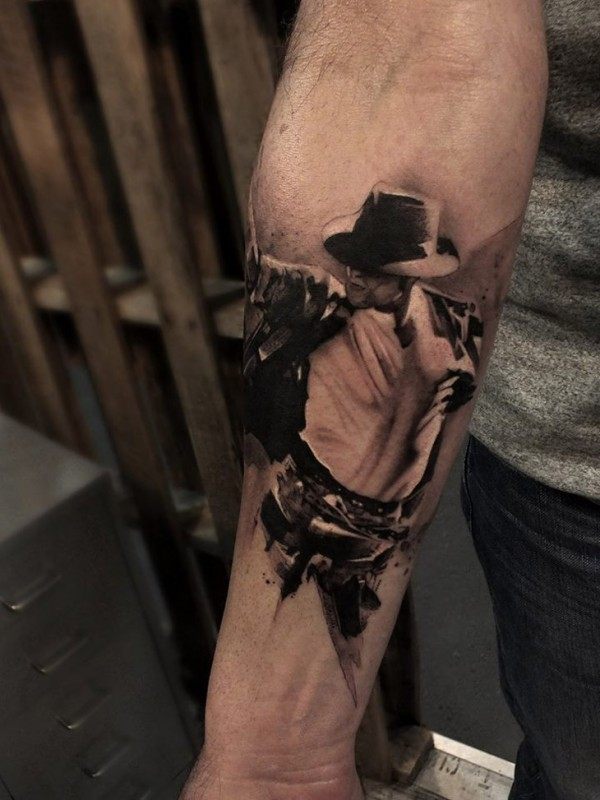 Black and gray style detailed arm tattoo of dancing Michael Jackson