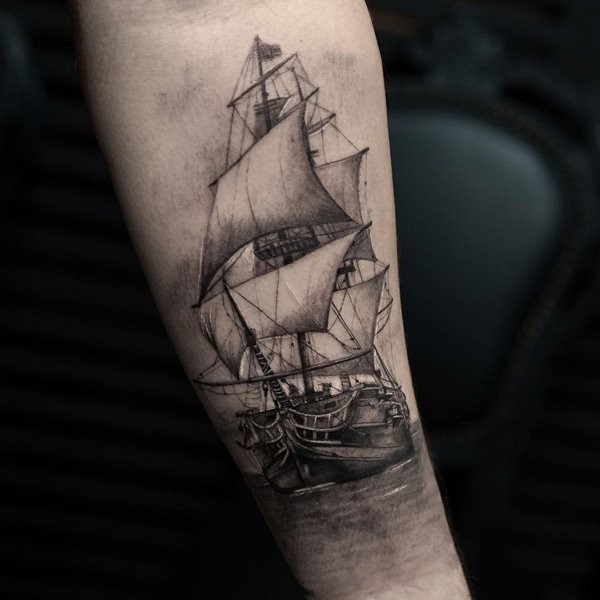 Black and gray style detailed arm tattoo of gorgeous sailing ship