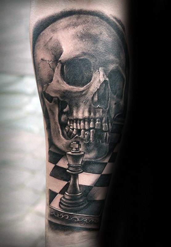 Black and gray style detailed forearm tattoo of human skull with chess figure