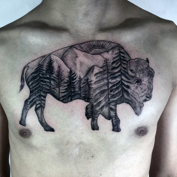 Black and gray style detailed grunting ox tattoo on chest stylized with mountain forest