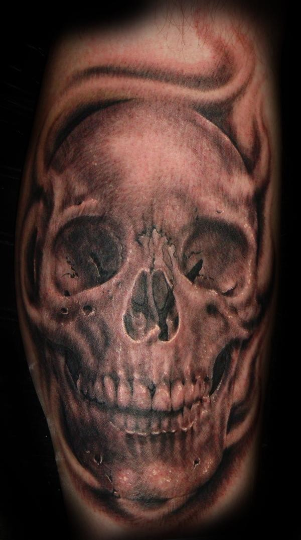 Black and gray style detailed leg tattoo of human skull