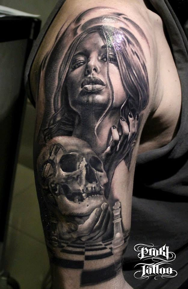 Black and gray style detailed shoulder tattoo of seductive woman with human skull