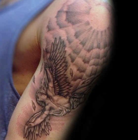 Black and gray style detailed shoulder tattoo of Icarus with sun