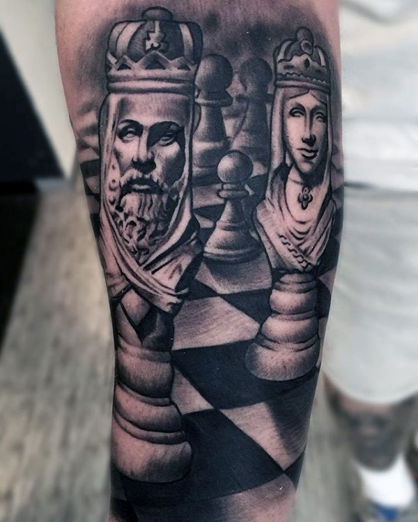 Black and gray style detailed shoulder tattoo of chess figures