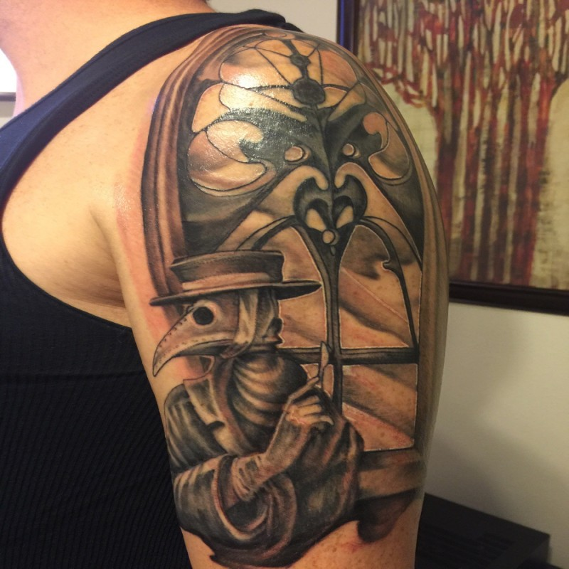 Black and gray style detailed shoulder tattoo of plague doctor near beautiful window