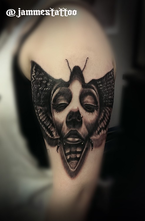 Black and gray style detailed shoulder tattoo of insect with woman face