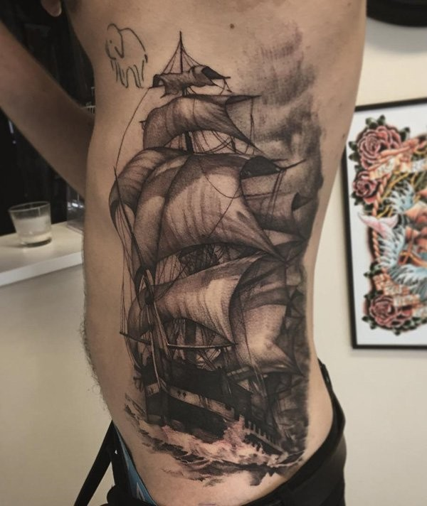 Black and gray style detailed side tattoo of cool sailing ship with waves