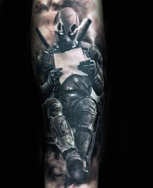 Black and gray style detailed tattoo of reading Deadpool