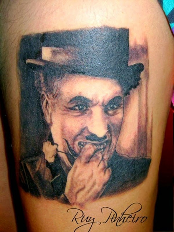 Black and gray style detailed thigh tattoo of Charlie Chaplin