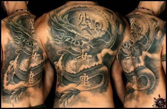 Black and gray style detailed whole back tattoo of ancient Asian statue