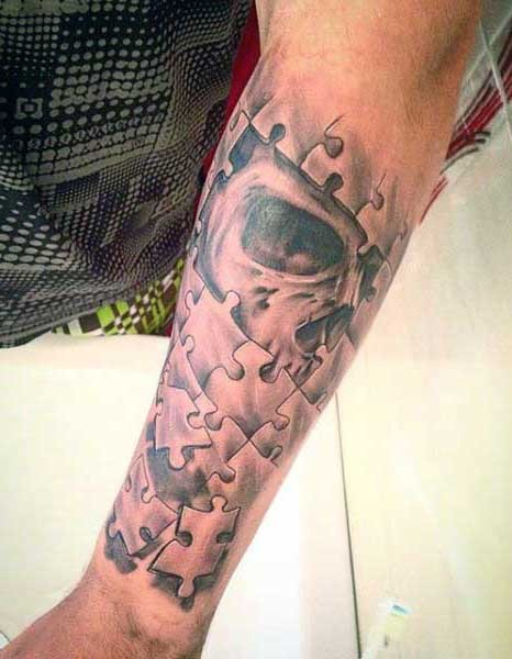 Black and gray style forearm tattoo of puzzle picture stylized with human skull