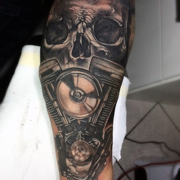 Black And Gray Style Forearm Tattoo Of Human Skull With