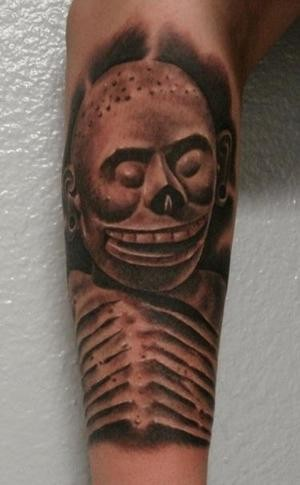 Black and gray style forearm tattoo of antic skeleton