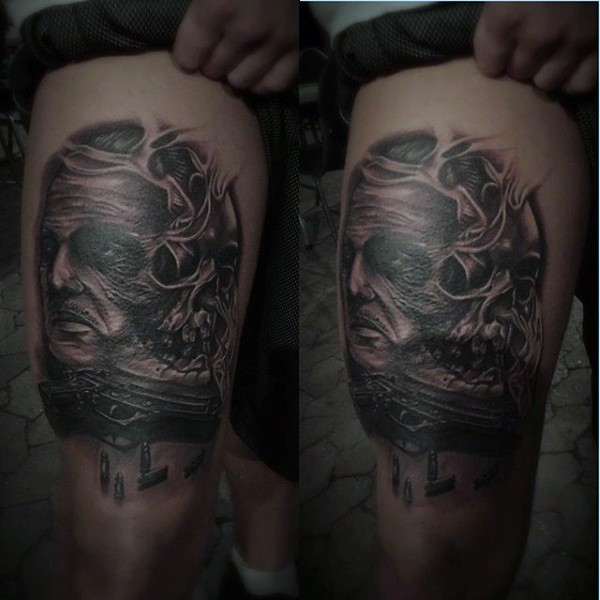 Black and gray style horror thigh tattoo of monster face with human skull