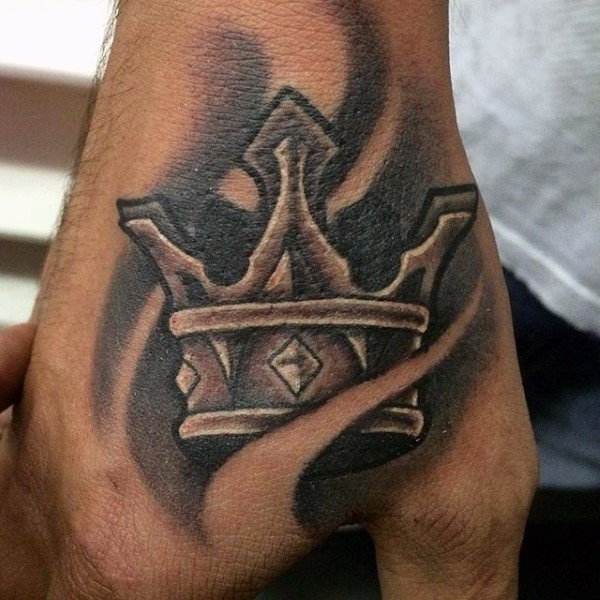 Black and gray style impressive looking hand tattoo of crown