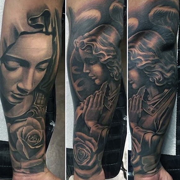 Black and gray style interesting looking tattoo of praying woman with roses