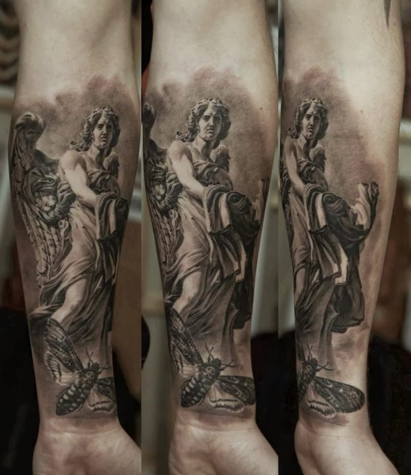 Black and gray style large forearm tattoo of stone statue