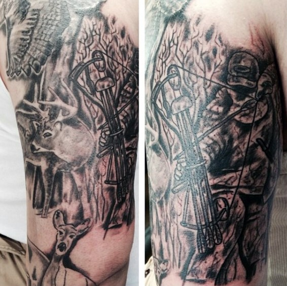 Black and gray style large shoulder tattoo of hunter with crossbow and deer