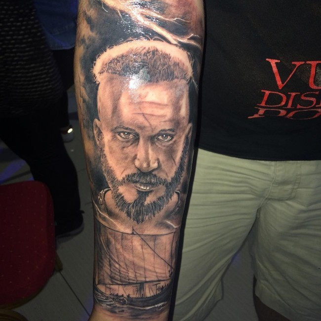 Black and gray style large sleeve tattoo of man face with old ship