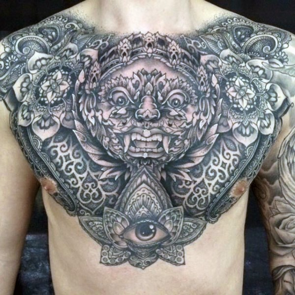 Black and gray style large very detailed chest and shoulders tattoo of ornamental flowers and fantasy dragon face