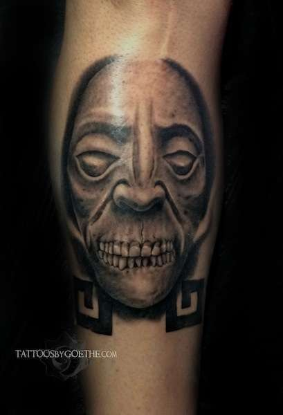 Black and gray style leg tattoo of demonic face