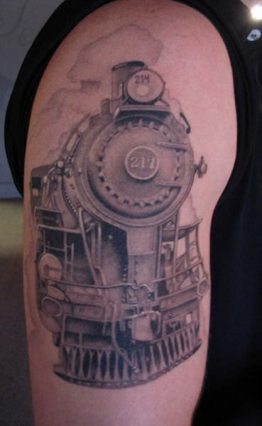 Black and gray style life like looking train tattoo on upper arm