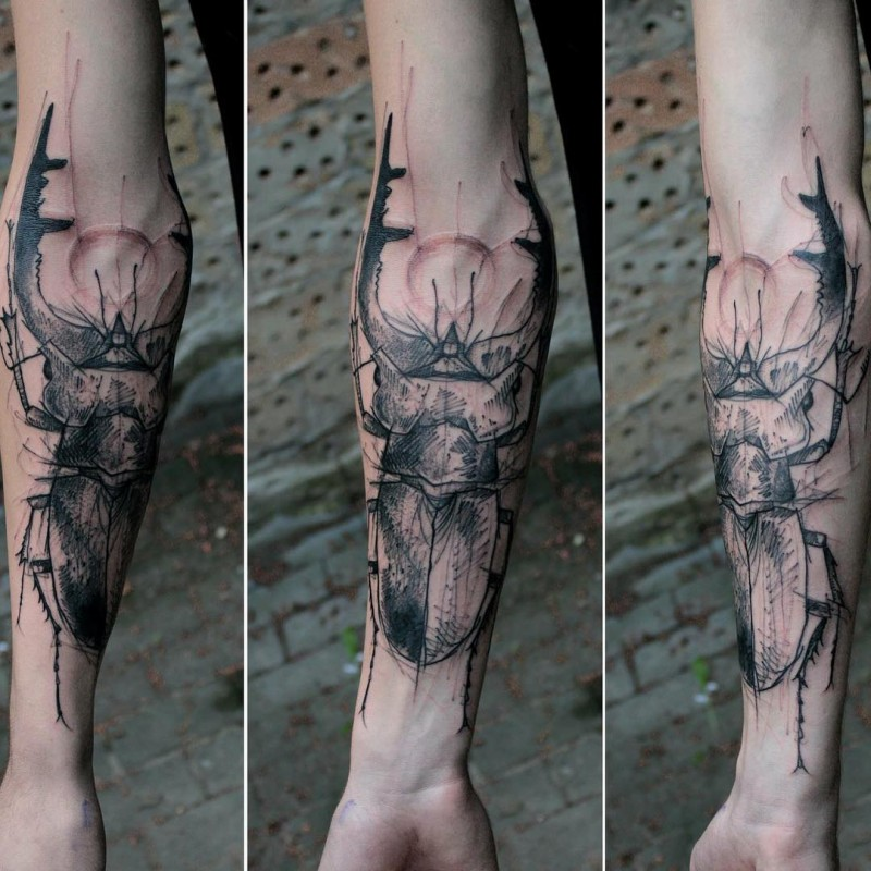 Black and gray style medium size forearm tattoo of big bug