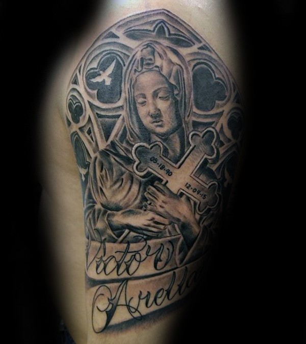 Black and gray style memorial woman with cross and lettering tattoo on shoulder