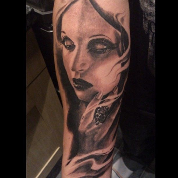 Black and gray style mystical woman portrait tattoo on forearm