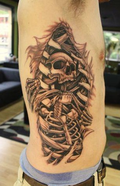 Black and gray style original looking side tattoo of human skeleton under bones