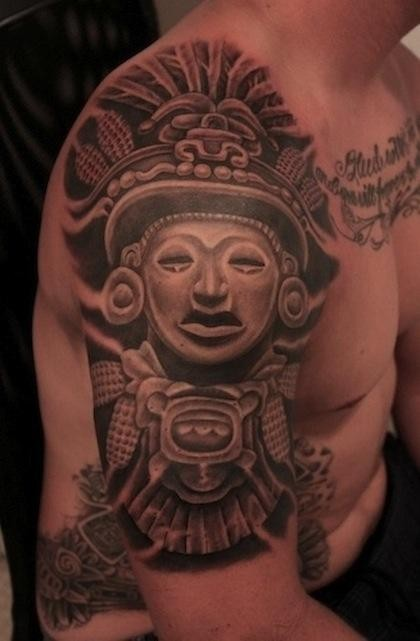 Black and gray style shoulder tattoo fo antic stone statue