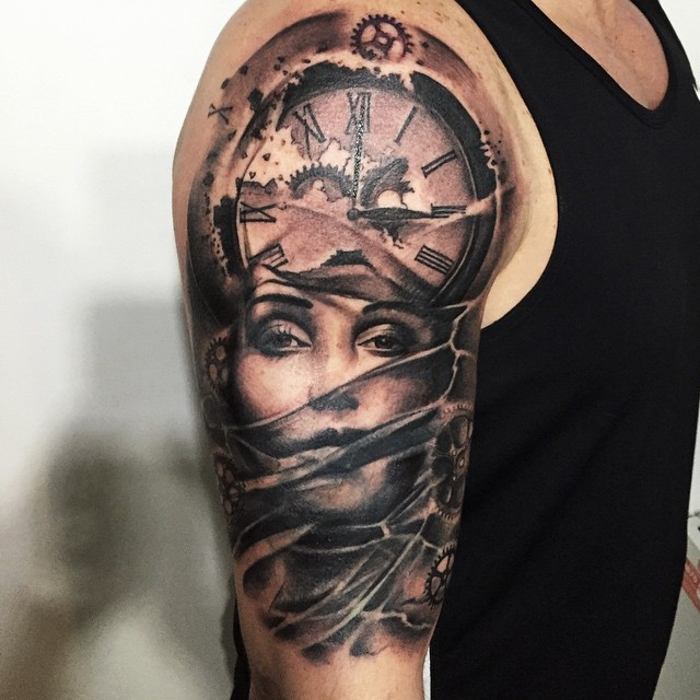 Black and gray style shoulder tattoo of woman with mechanical clock