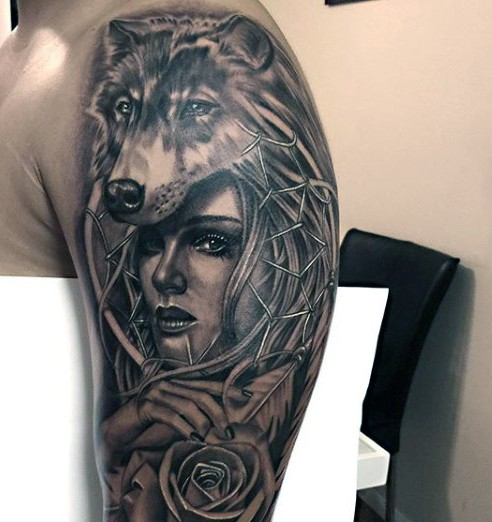 Black and gray style shoulder tattoo of woman with rose and wolf helmet